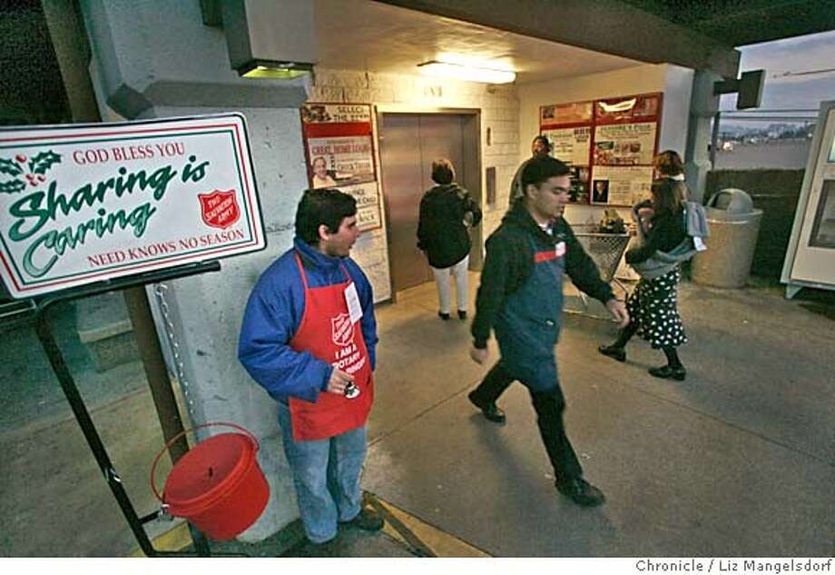 salvation1_lm.JPG Event on 11/30/04 in San Francisco.  Aaron Valdez greets people as he rings the salvation army bell on the top level of the parking garage at the Safeway on Taraval at 17th Ave. Liz Mangelsdorf / The Chronicle MANDATORY CREDIT FOR PHOTOG AND SF CHRONICLE/ -MAGS OUT Nation#MainNews#Chronicle#12/1/2004#ALL#5star##0422493281 Photo: Liz Mangelsdorf