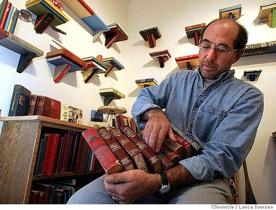 EBLARTISIANS045.jpg_  Jim Rosenau is a featured artisan in this year's Berkeley Artisans Holiday Open Studios, running 11/27-12/19. Rosenau is a literate carpenter with a whimsical perspective. Result: he creates custom-built shelves and bookcases out of used books. He started making his bookshelves out of books because he grew up surrounded by books. By Lance Iversen/San Francisco Chronicle Photo: Lance Iversen