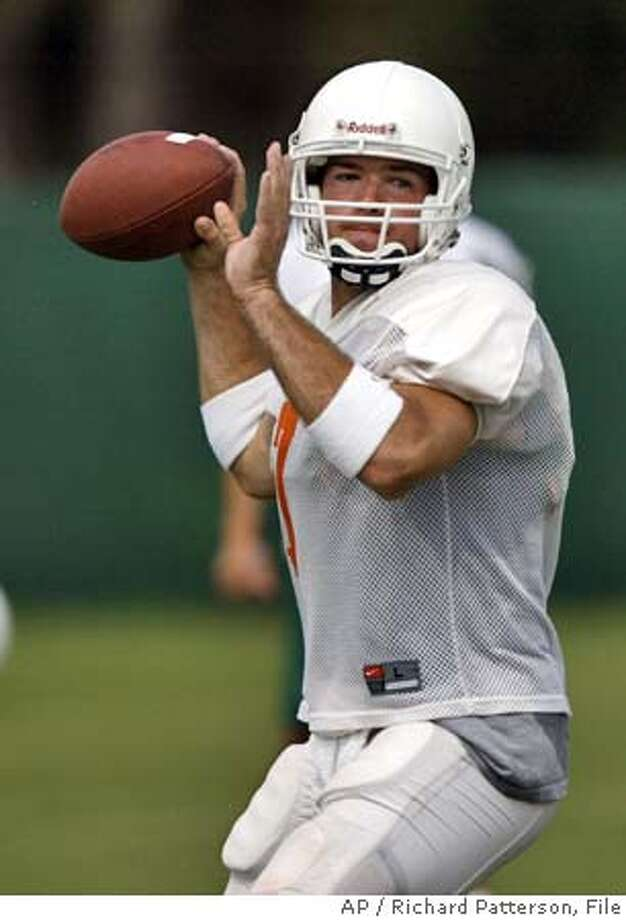 ** FILE ** Miami quarterback Brock Berlin (7) drops back to pass during an afternoon scrimmage in Coral Gables, Fla., in this Aug. 13, 2003 photo. When Brock Berlin was piling up yards and winning championships at Evangel Christian Academy in Shreveport, La., it seemed only a matter of time before he would be the starting quarterback at some college football powerhouse. Nearly four years and two colleges after throwing his last high school pass, Berlin is finally No. 1. (AP Photo/Richard Patterson) cat A Aug. 13, 2003 file photo Sports#Sports#Chronicle#12/3/2004#ALL#5star#c4#0421361601 Photo: RICHARD PATTERSON