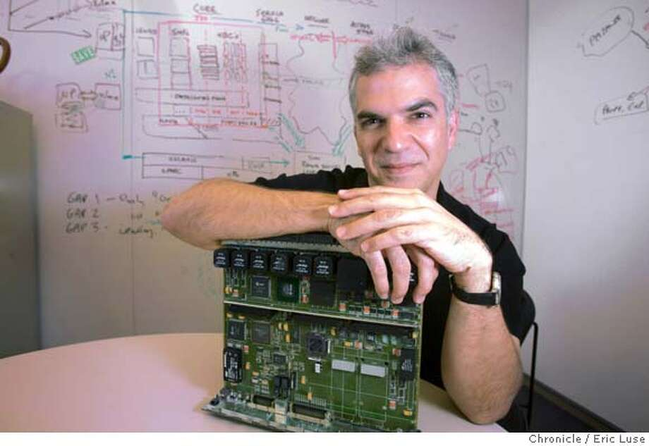 suncto00_005_el.jpg  Sun Microsystems Chief Technology Officer Greg Papadopoulos with the IO Board from the mid 1990's that launched Sun Microsystems high volume servers. He has been holding monthly meetings with Microsoft founder Bill Gates as part of a truce signed between the two rivals. Story is a profile of Papadopoulos. Event on 11/3/04 in Menlo Park. Eric Luse / The Chronicle MANDATORY CREDIT FOR PHOTOG AND SF CHRONICLE/ -MAGS OUT Business#Business#Chronicle#11/30/2004#ALL#5star##0422447185 Photo: Eric Luse