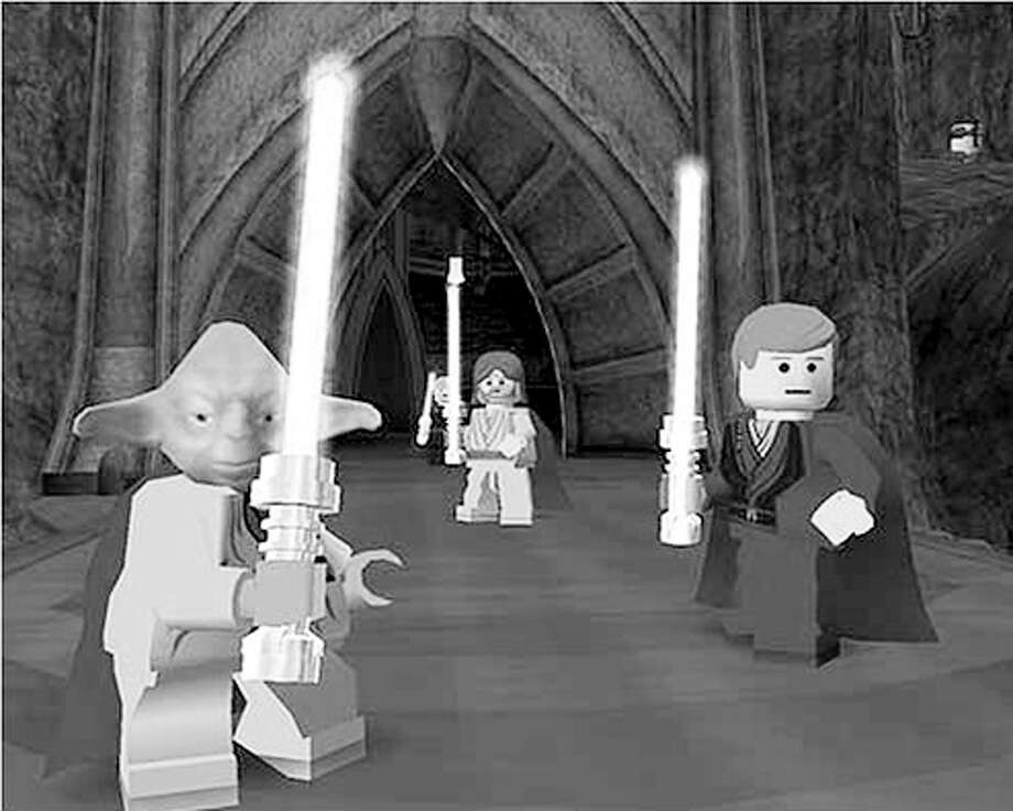 Yoda, with Jedi knights Anakin Skywalker and Obi-Wan Kenobi (center) as Lego figures in the Lego Star Wars game. Image courtesy of Lego