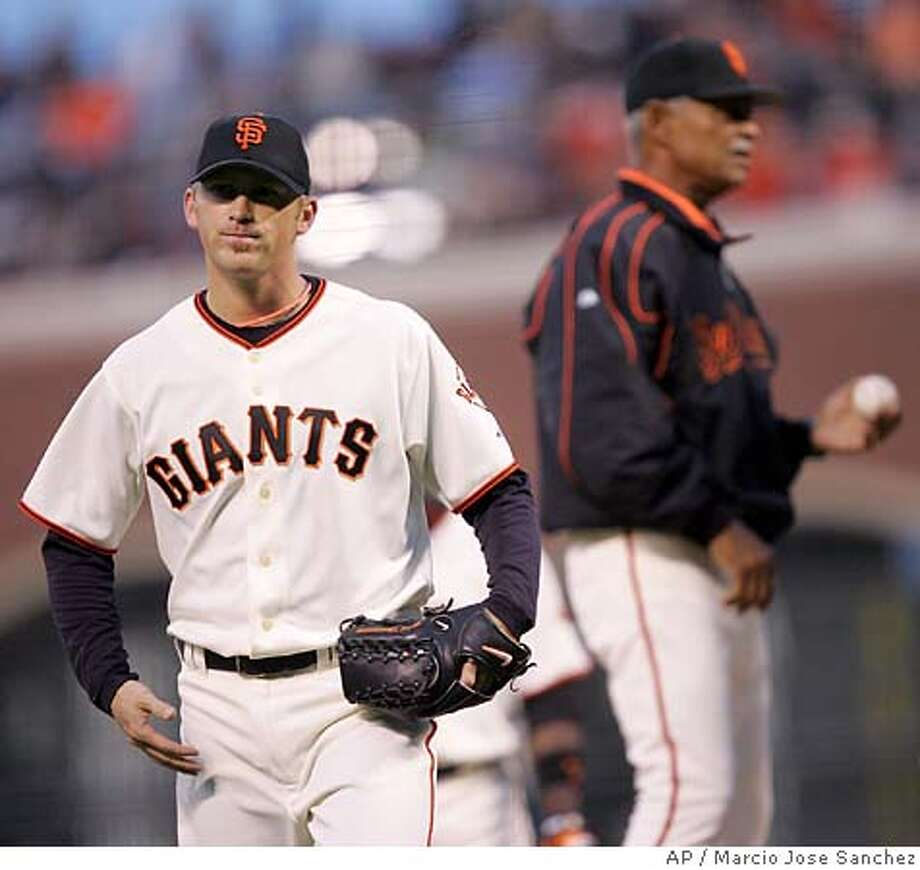 San Francisco Giants starter Brad Hennessey, left, is pulled from the game by manager Felipe Alou, right, with the bases loaded in the third inning against the San Diego Padres on Friday, May 27, 2005, in San Francisco. (AP Photo/Marcio Jose Sanchez) Photo: MARCIO JOSE SANCHEZ