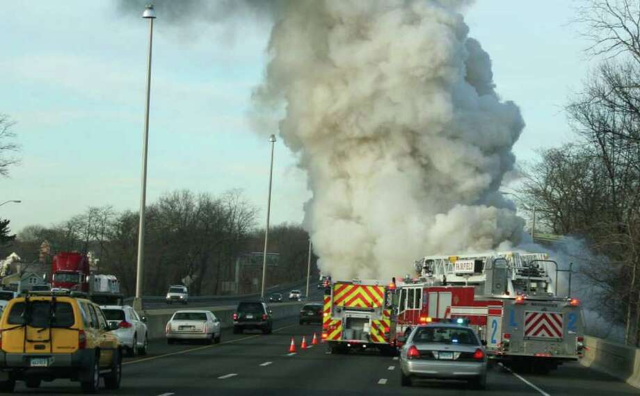 Smoke billows from a minivan fire on Interstate 95 in Fairfield, between southbound Exits 25 and 24, which tied up morning commuter traffic Thursday. The driver was uninjured. Photo: Fairfield Fire Department / Fairfield Citizen contributed