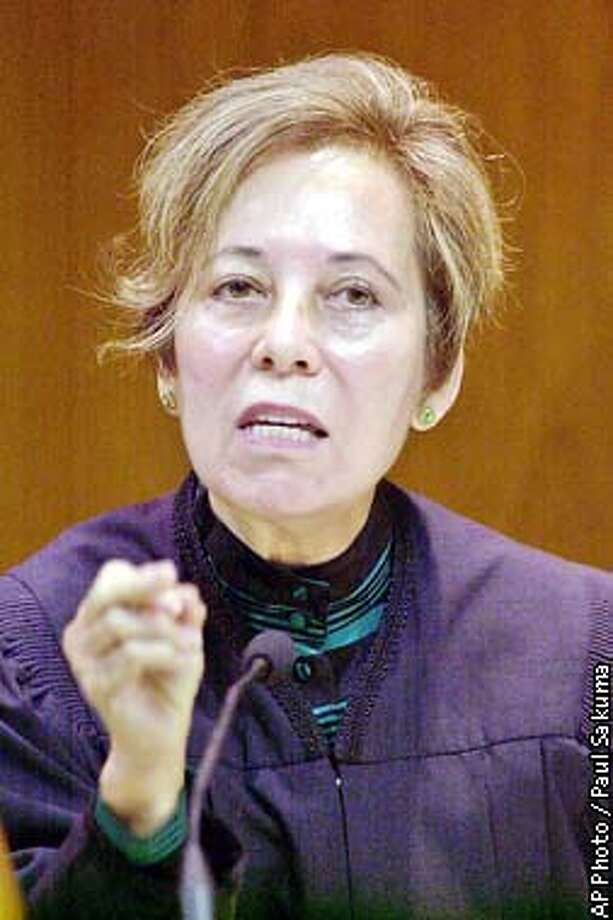 California Supreme Court Justice Joyce Kennard gestures in a courtroom in Fresno, Calif., Tuesday, Oct. 8, 2002. The court begins considering whether the governor has absolute power to overturn the Board of Prison Terms position to parole convicted murderers. (AP Photo/Paul Sakuma) Photo: PAUL SAKUMA
