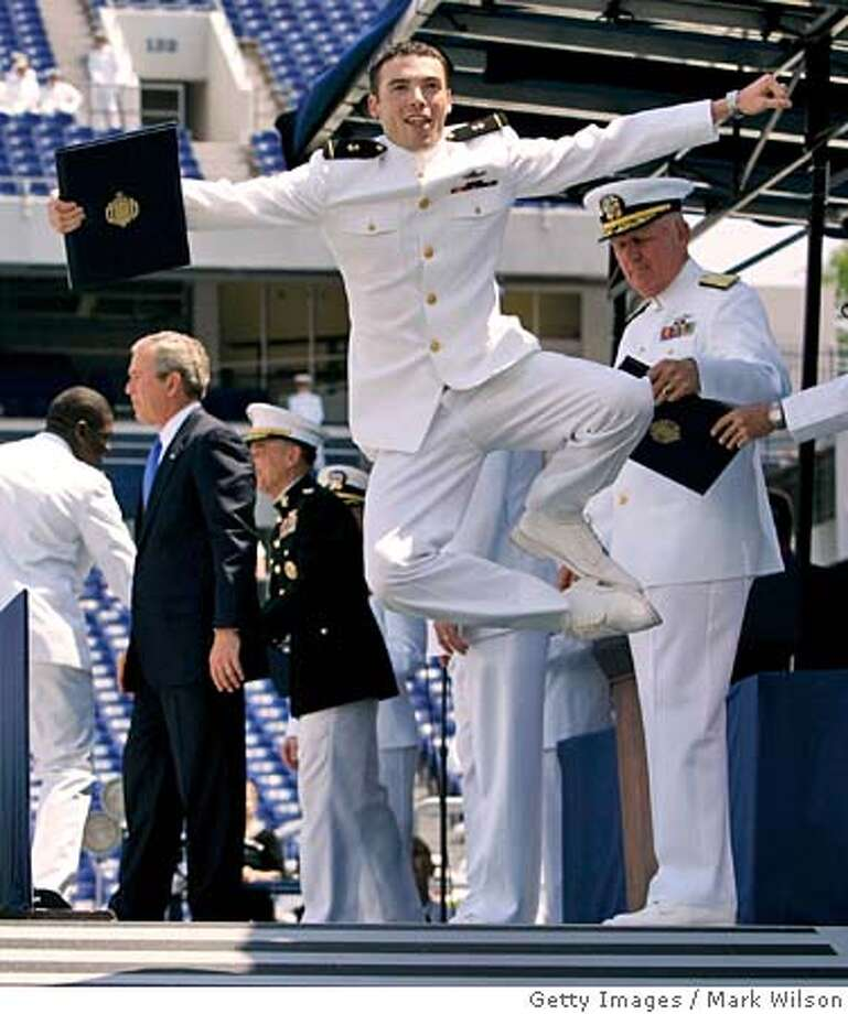 ANNAPOLIS, MD - MAY 27: A U.S. Naval Academy graduate jumps up in the air after recieving his diploma from U.S. President George W. Bush (2nd-L) during graduation ceremonies May 27, 2005 in Annapolis, Maryland. The class of 2005 was just starting their freshman year when the September 11th attacks happened. (Photo by Mark Wilson/Getty Images) *** Local Caption *** George W. Bush Photo: Mark Wilson