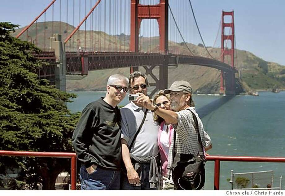 digital23_ch_051.jpg  Mark Longton, David Longton, Ruth Longton Ashley and Paul Longton, all brothers and sisters pose in front of the bridge.  Illustration of the popularity of digital cameras. These are tourists at the Golden Gate bridge in San Francisco  5/22/05 Chris Hardy / San Francisco Chronicle Photo: Chris Hardy