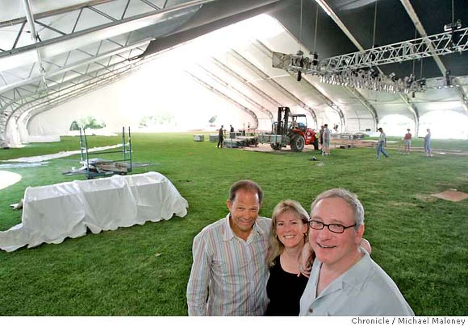 SONOMAJAZZ26_008_MJM.jpg  From left, Jim Horowitz and Stephanie and Jim Pugash inside the huge tent where workers are busy setting up for this weekend's jazz festival.  A giant white tent has risen in a Sonoma field for the ambitious new Sonoma Jazz Fest, which debuts this weekend. Jim and Stephanie Pugash is the chair. and pres of board of the event, and Jim Horowitz, the Aspen-based jazz promoter is the executive producer. Photo by Michael Maloney / San Francisco Chronicle MANDATORY CREDIT FOR PHOTOG AND SF CHRONICLE/ -MAGS OUT Photo: Michael Maloney