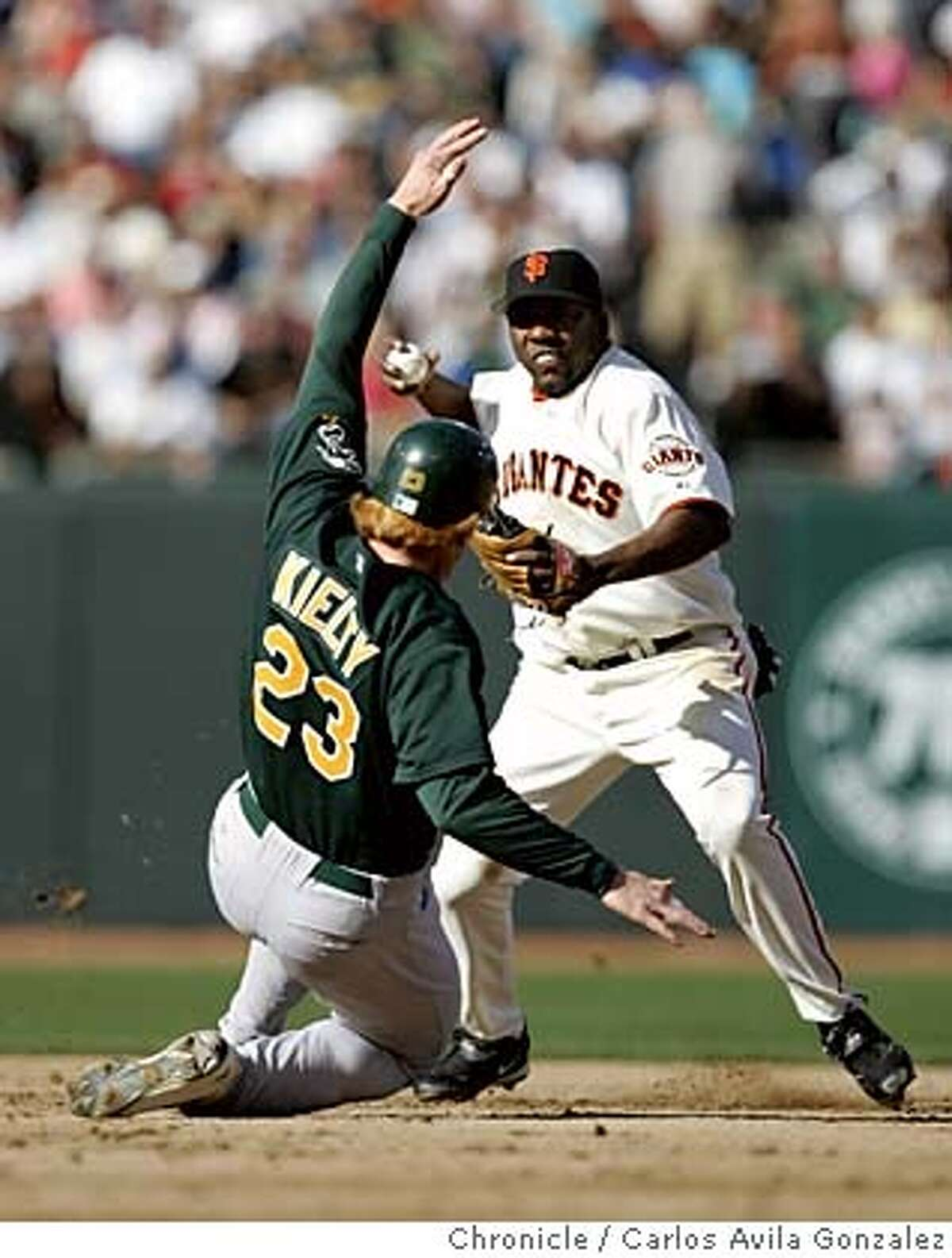 Athletics' Bobby Kielty, tries to break up a double play by Giants' short stop, Deivi Cruz, in the top of the second inning, on a hit by Erubiel Durazo. The San Francisco Giants played the Oakland Athletics at SBC Park in San Francisco, Ca., on Sunday, May 22, 2005. The Giants defeated the Athletics 3-1. Photo by Carlos Avila Gonzalez / The San Francisco Chronicle Photo taken on 5/22/05, in San Francisco,CA.