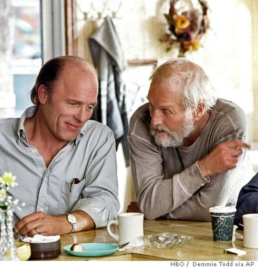"In this undated publicity photo released by HBO, actors Ed Harris, left, and Paul Newman appear in a scene from the HBO film ""Empire Falls."" The two-part movie, based on the Pulitzer Prize-winning novel by Richard Russo, premieres on HBO at 9 p.m., EDT, Saturday and Sunday, May 28 and 29. (AP Photo/HBO, Demmie Todd) Photo: DEMMIE TODD"