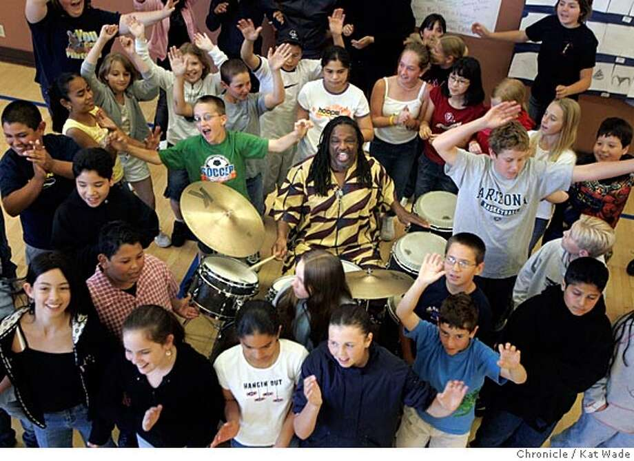 On 5/16/05 in the Healdsburg master drummer and musician Babatunde Lea (CENTER at drums) poses for a portrait with members of three fifth grade classes that he finished teaching a month ago at Healdsburg Elementary School. Lea, who will be the grand finale at the 7th annual Healdsburg Jazz Festival is a leader in Healdsburg's jazz-in-the-schools program sponsored by the festival's founder Jessica Felix. Kat Wade/ The Chronicle Photo: Kat Wade