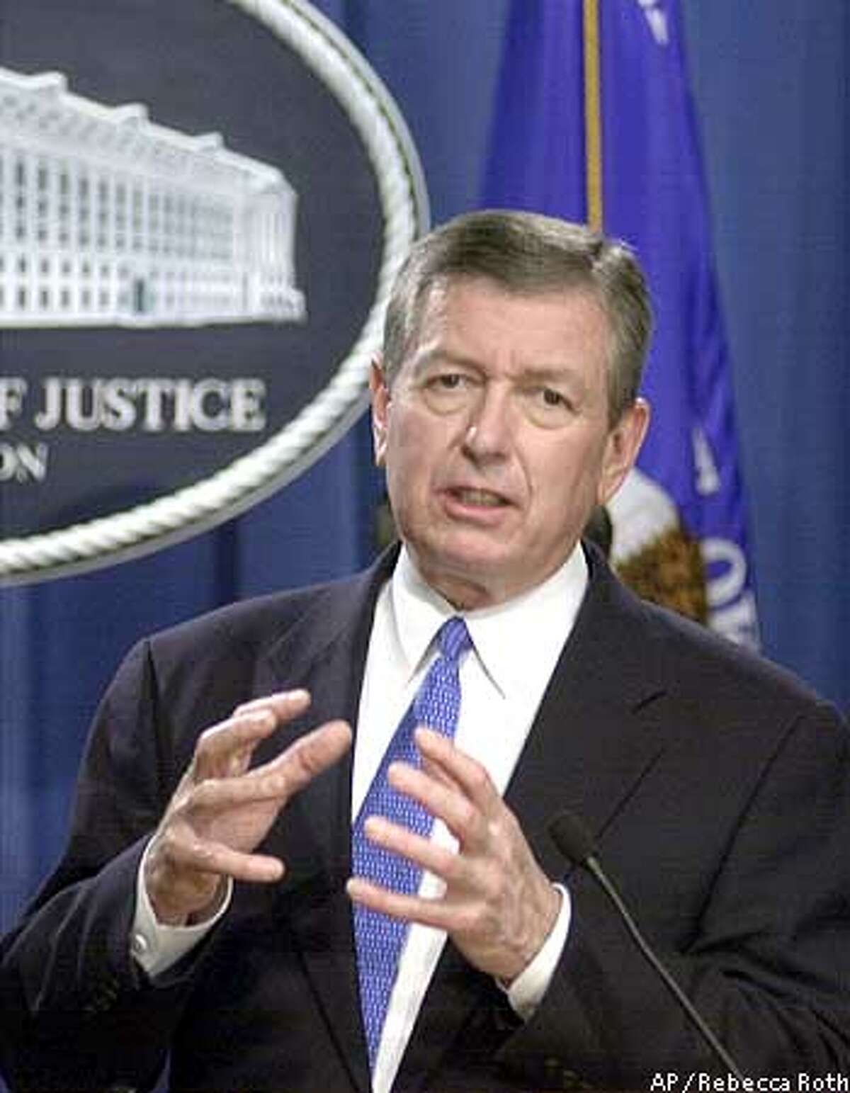"""Attorney General John Ashcroft gestures during a news conference at the Justice Department in Washington Monday, Feb. 24, 2003 to announce that three dozen people were charged Monday in federal indictments with trafficking in illegal from coast to coast, using both traditional stores and the Internet. Twenty-seven people were charged in 17 indictments returned by a grand jury western Pennsylvania as part of """"Operation Pipe Dreams,"""" an investigation that stretched from Pittsburgh to Phoenix to southern California. (AP Photo/Rebecca Roth)"""