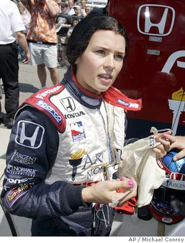 ** ADVANCE FOR WEEKEND EDITIONS, MAY 28-29 ** Indy Racing League driver Danica Patrick talks about her drive during practice during the opening day at the Indianapolis Motor Speedway, Sunday, May 8, 2005. Patrick will start her first Indianapolis 500 from the second row after qualifying at 227.004 mph. (AP Photo/Michael Conroy) Photo: MICHAEL CONROY