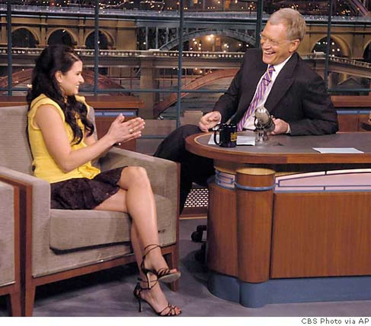 Indy Racing League rookie driver Danica Patrick, of Roscoe, Ill., talks with CBS Late Show Host David Letterman in New York Monday, May 23, 2005. Patrick will be driving for the Rahal-Letterman team at the Indianapolis 500 on Memorial Day. (AP Photo/CBS, J.P. Filo)