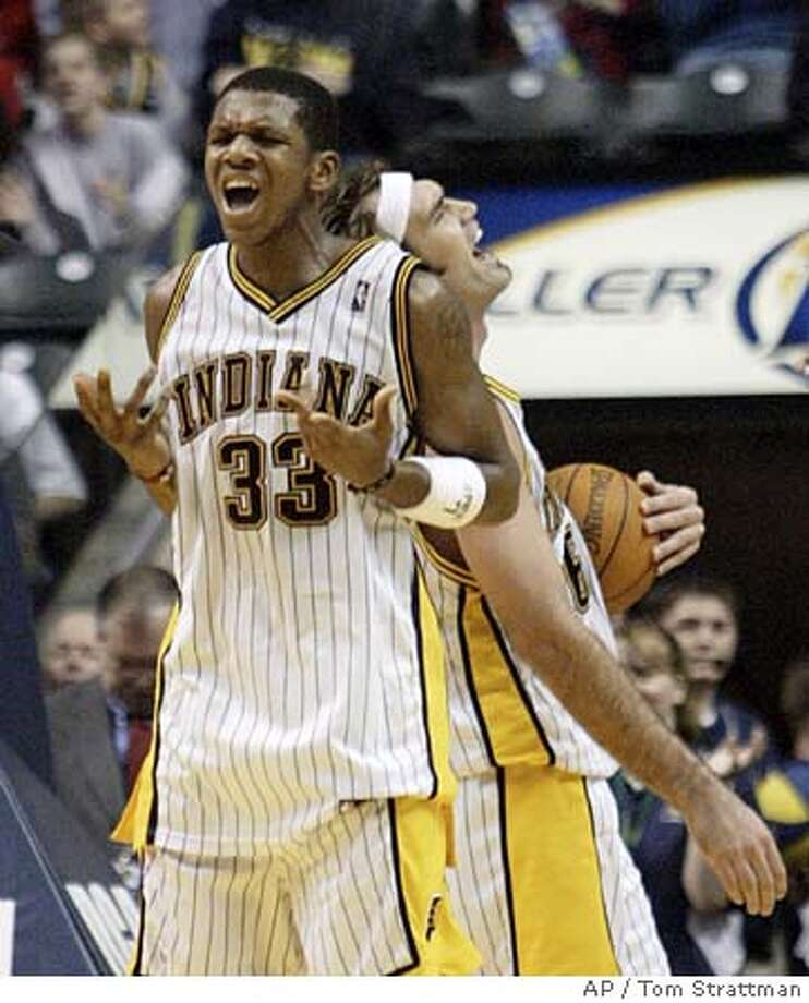 Indiana Pacers forward James Jones (33) and Scot Pollard react after Jones was fouled after making a basket against the Boston Celtics during fourth quarter in Indianapolis., Tuesday, Nov.23, 2004. Jones finsihed with 22 points and 10 rebounds in the Pacers 106-96 win. (AP Photo/Tom Strattman) Sports#Sports#Chronicle#11/28/2004#ALL#2star##0422483073 Photo: TOM STRATTMAN