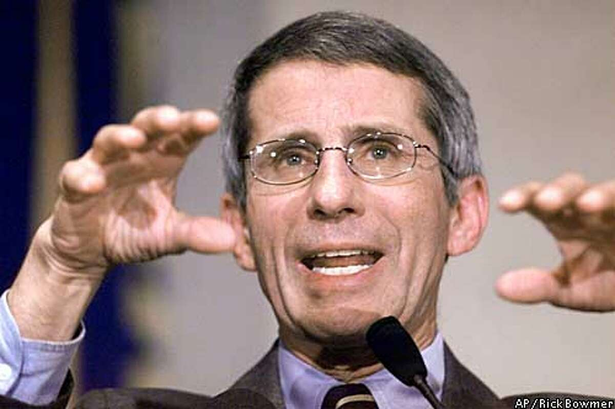 FILE--Dr. Anthony Fauci, director of the National Institute of Allergy and Infectious Disease gestures during an address on bioterrorism in this, Oct. 31, 2001 file photo at the National Institutes of Health in Behtesda, Md. Health and Human Services Secretary Tommy Thompson has been pushing for months to appoint Fauci to be National Instututes of Health director, but the White House will not sign off on him. (AP Photo/Rick Bowmer, Files)