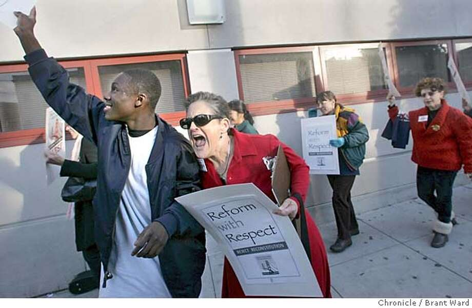 protest158_ward.jpg Retired teacher Hene Kelly and O'Connell student Jonathon McNair, 14, got into the spirit of the protest chanting together in front of the school.  The San Francisco teacher's union stages a protest in front of John O'Connell High School Tuesday afternoon decrying the requirement that teachers working in the new Dream schools reapply for their jobs. Brant Ward 12/1/04 Metro#Metro#Chronicle#12/1/2004#ALL#5star##0422493176 Photo: Brant Ward
