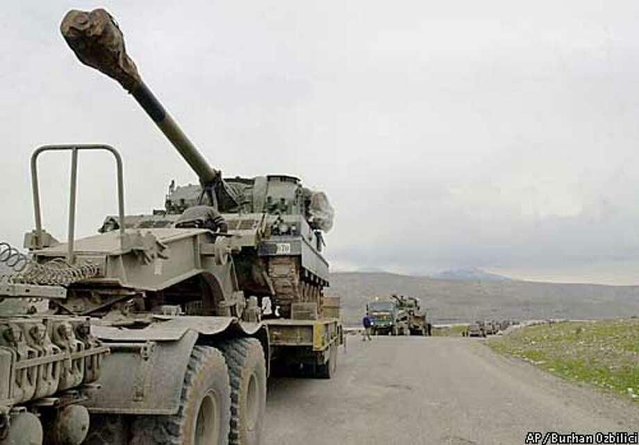 A column of self-propelled howitzers of the Turkish army arrive in Cizre, near the Iraqi border on Sunday, Feb. 23, 2003. The Turks are fortifying the Iraqi border in preparation of the arrival of U.S. combat troops to open a northern front in northern Iraq for a possible war with Iraq. (AP Photo/Burhan Ozbilici) Photo: BURHAN OZBILICI