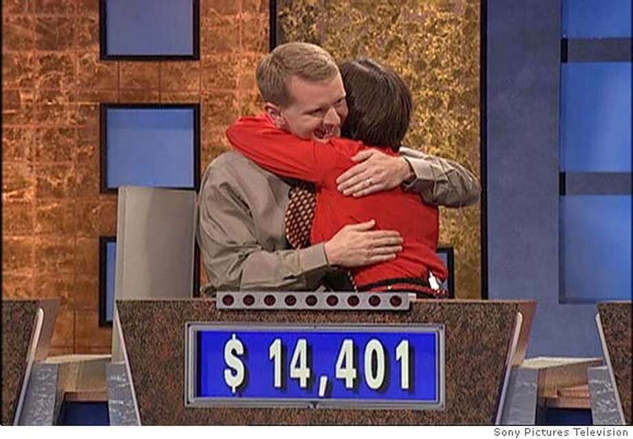 "(NYT34) UNDATED -- Nov. 30, 2004 -- JEAPORDY-TV -- In this video frame grab provided by Sony Pictures Television, ""Jeopardy!"" contestants Ken Jennings, left, and Nancy Zerg hug after Jennings ended his 74-game winning streak on the show, taped Sept. 7, 2004, at Sony Studios in Culver City, Calif. His winnings totaled over two and a-half million dollars. Jennings last game is to be broadcast on Tuesday, Nov. 30, 2004. (Sony Pictures Television/The New York Times) XNYZ Nation#MainNews#Chronicle#12/1/2004#ALL#5star##0422493024 Photo: SONY PICTURES TELEVISION"