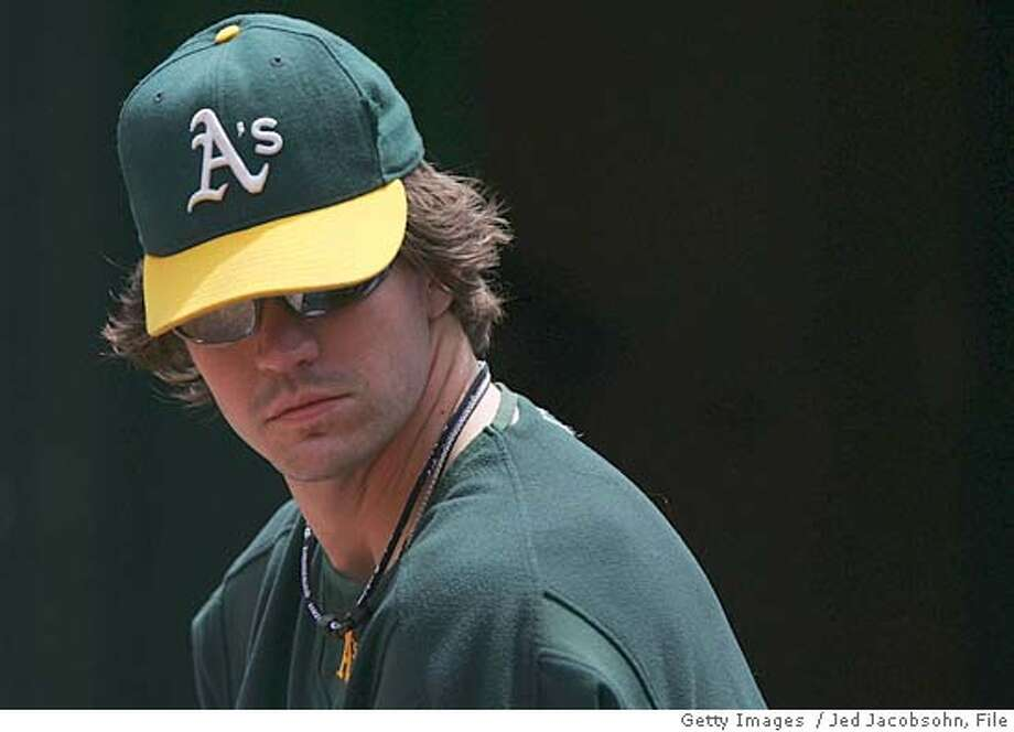 OAKLAND, CA - MAY 15: Barry Zito #75 of the Oakland Athletics watches the game against the New York Yankees at McAfee Coliseum on May 15, 2005 in Oakland, California. The Yanks defeated the A's 6-4. (Photo by Jed Jacobsohn/Getty Images) *** Local Caption *** Barry Zito Photo: Jed Jacobsohn