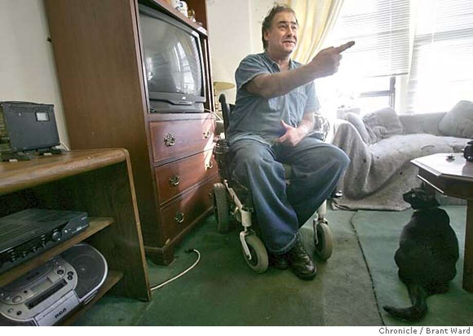 sos_flagge142_ward.jpg John talks about his accident in his apartment...his cat listens as he recounts the story...he claims radio waves triggered the chair into high gear.  John Flagge is a disabled man who lives in the low-rent Marlton Manor residential hotel in the Tenderloin. He lost control of his motorized wheelchair last spring and smashed into the wall of the hotel. SOS is fixing the damage to the marble wall. Brant Ward 11/24/04 Metro#Metro#Chronicle#12/1/2004#ALL#5star##0422489503 Photo: Brant Ward