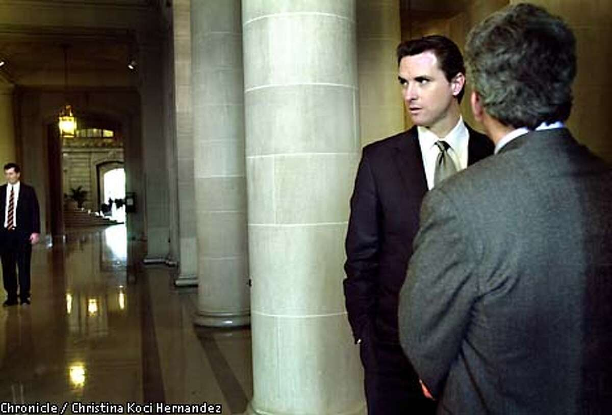 CHRISTINA KOCI HERNANDEZ/CHRONICLE Supervisor Gavin Newsom chats with a colleague in the corridors of City Hall before he address a large crowd of supporters in the Green Room, after he was sworn-in as Supervisor.