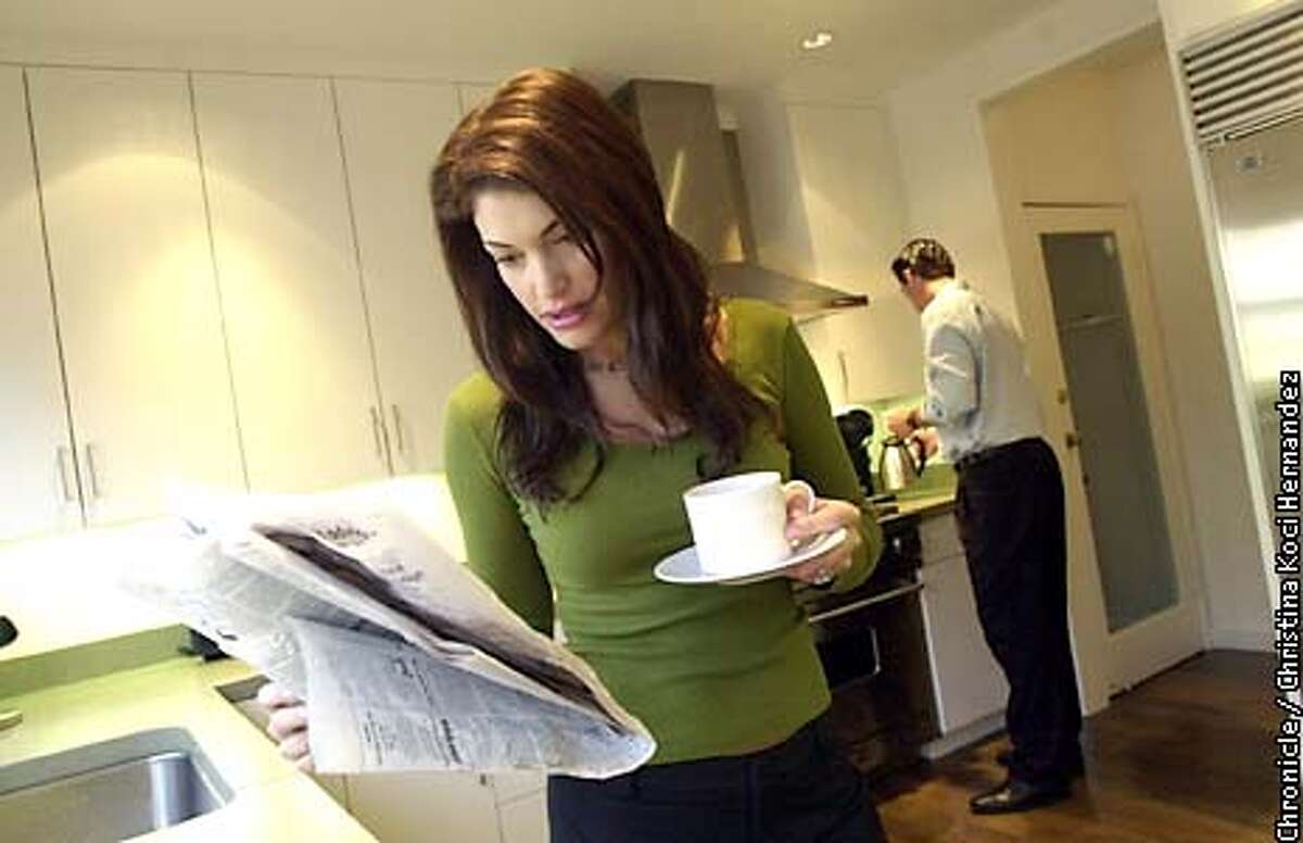 CHRISTINA KOCI HERNANDEZ/CHRONICLE Kimberly reads paper in the morning with Gavin in the kitchen.Gavin Newsom at home with wife, Kimberly Guilfoyle Newsom.