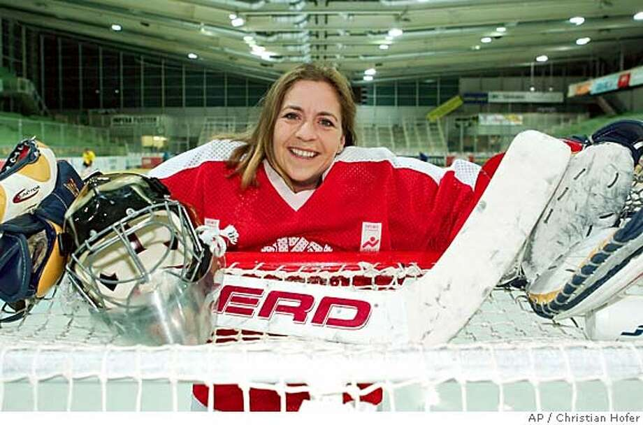 "Austrian ice hockey goalie Barbara Zemann poses for a photograph, on Thursday, Nov. 25, 2004, in Vienna. Barbara Zemann, the first woman to suit up for an Austrian hockey team, was formally presented Monday as KSV Feuerwehr's new goalie, breaking the gender barrier and achieving what she calls ""a dream come true"". (AP Photo/Christian Hofer) Sports#Sports#Chronicle#11/30/2004#ALL#5star##0422491259 Photo: CHRISTIAN HOFER"