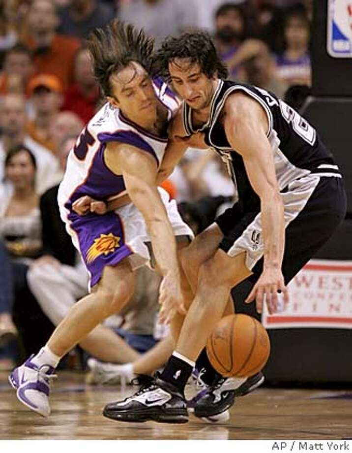 Phoenix Suns' Steve Nash, left, and San Antonio Spurs' Manu Ginobili scramble for a loose ball during the third quarter Tuesday, May 24, 2005 at America West Arena in Phoenix in game two of the Western Conference Finals. (AP Photo/Matt York) Photo: MATT YORK