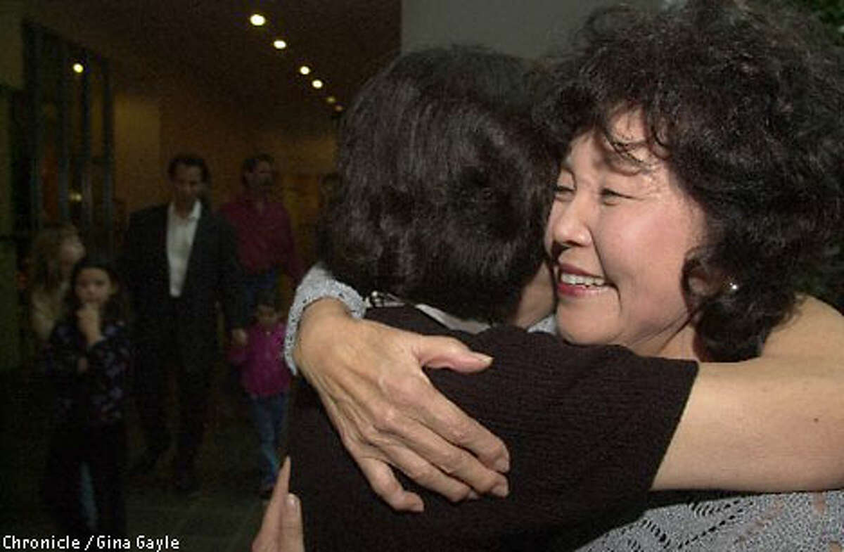 Nancy Kawata, right, and Carolyn Adams embrace after meeting for the first time in 61 years. The two childhood friends lost touch after their families were sent to internment camps. Chronicle photo by Gina Gayle