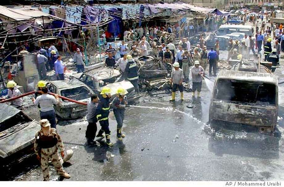 The scene at the site of a car bomb which exploded at lunchtime outside the popular Habayibna restaurant where police officers often meet for lunch, in the Talibia area of northern Baghdad, Iraq Monday, May 23, 2005, killing at least seven people and injuring more than 80 according to eyewitnesses and hospital officials. (AP Photo/Mohammed Uraibi) Photo: MOHAMMED URAIBI