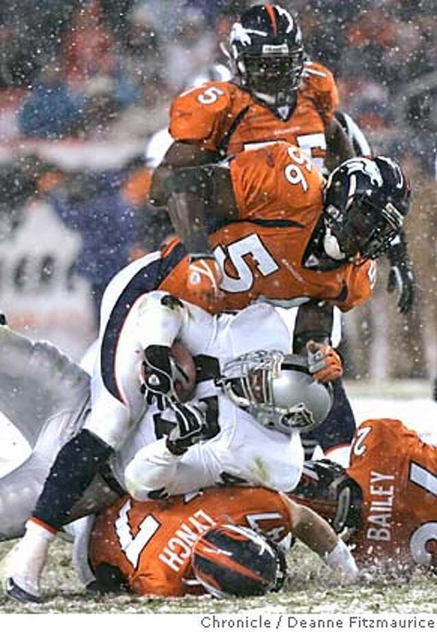 raiders_433_df.JPG  Tyrone Wheatley is sandwiched in a pile of Broncos. He later was injured and taken out of the game. Oakland Raiders vs the Denver Broncos in a snowstorm at Invesco Field at Mile High in Denver Colorado.  Deanne Fitzmaurice / The Chronicle MANDATORY CREDIT FOR PHOTOG AND SF CHRONICLE/ -MAGS OUT Sports#Sports#Chronicle#11/29/2004#ALL#5star##0422490466 Photo: Deanne Fitzmaurice