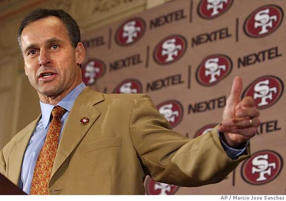Mike Nolan, former defensive coordinator for the Baltimore Ravens, addresses the media after being introduced as the new head coach of the San Francisco 49ers on Wednesday, Jan. 19, 2005 in San Francisco. (AP Photo/Marcio Jose Sanchez) Ran on: 01-27-2005  Mike Nolan is close to hiring several coaches, including an offensive coordinator. Photo: MARCIO JOSE SANCHEZ