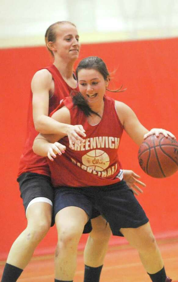 "Erica Ambrogio, right, is the sixth man for the Greenwich High School girl's basketball team. ""Day in and day out she goes hard in every drill. And although her efforts don't always show in the box score, her heart and determination are unmatched,"" says GHS coach Chrys Hernandez. Here, Ambrogio goes at it during practice with Amanda Onofrio, GHS co-captain. Photo: Helen Neafsey / Greenwich Time"
