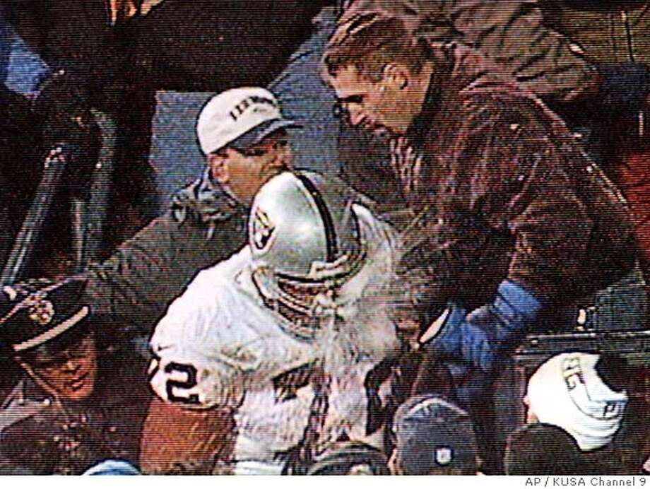 Oakland Raiders offensive tackle Lincoln Kennedy is hit in the face by a snowball that was thrown at him as he argued with fans following Oakland' 27-21 overtime loss to the Denver Broncos on Monday, Nov. 22, 1999, in Denver, in this image from televison. Kennedy punched a fan after getting hit in the face by a snowball. Kennedy filed charges against the fan, and police said Kennedy was not cited because he had the right to fight back after getting hit by the snowball. An arrest warrant was also issuedfor Raiders cornerback Charles Woodson, who allegedly hurled a snowball that struck a female fan in the face. (AP Photo/KUSA Channel 9) CAT Sports#Sports#Chronicle#11/25/2004#ALL#5star##422036998