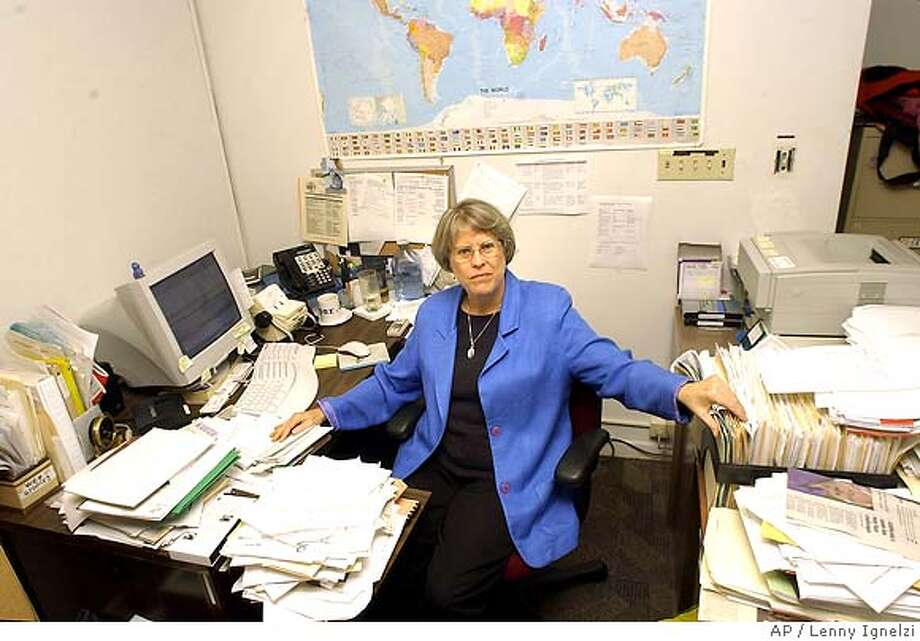"** FOR USE IN YEAR-END EDITIONS WITH STORY SLUGGED YE PRIVACY CHALLENGE ** Beth Givens, the director of the Privacy Rights Clearinghouse, sits at her desk surrounded by files she refers to as ""her projects"" Monday Dec. 8, 2003 in San Diego. ""I consider the issue of public records on the Internet to be one of the most challenging public policy issues of our time,"" said Givens. (AP Photo/Lenny Ignelzi) Foreign#MainNews#Chronicle#12/12/2003#ALL#Advance#D11#0421524063 Privacy advocate Beth Givens calls public records on the Internet &quo;one of the most challenging public policy issues of our time.&quo; Ran on: 02-25-2005  Beth Givens, director of the Privacy Rights Clearinghouse. Nation#MainNews#Chronicle#12/12/2003#ALL#Advance#D11#0421524063 CAT Photo: LENNY IGNELZI"