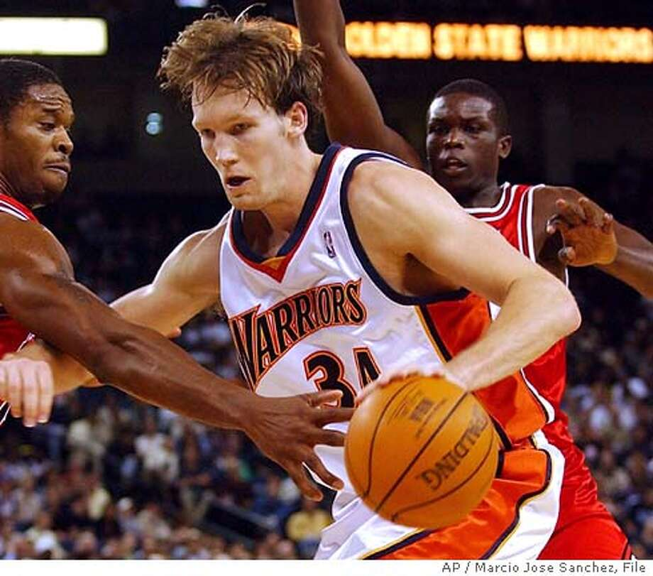 Golden State Warriors' Mike Dunleavy, middle, is guarded by the Chicago Bulls' Antonio Davis, left, and Luol Deng of Sudan, right, in Oakland, Calif. on Wednesday, Nov. 17, 2004. (AP Photo/Marcio Jose Sanchez) Photo: MARCIO JOSE SANCHEZ