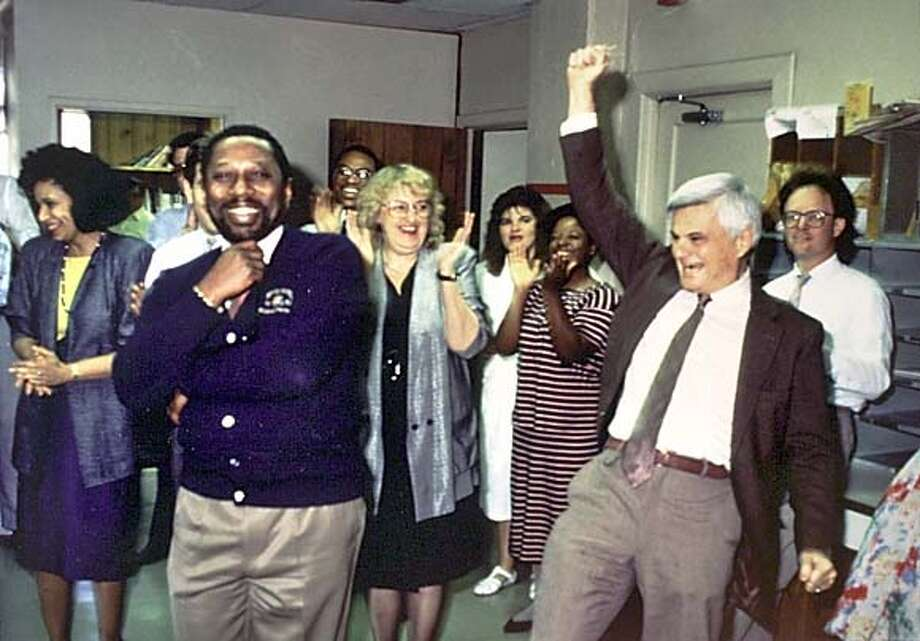 WBROYO8E-C-01SEP00-SF-HO - Leroy Aarons (R) reacts to the Oakland Tribune winning the Pulitzer Prize for its coverage of the 1989 Loma Prieta earthquake. At left is Robert Maynard, publisher of the paper. Aarons was the editor of the Oakland Tribune and founder of the National Lesbian and Gay Journalists Association. He lives with Joshua Boneh, 43, his partner of 20 years, at 626 Gold Ridge Road, Sebastopol. HANDOUT PHOTO CAT Metro#Metro#Chronicle#11/30/2004#ALL#5star##422076869 Photo: HANDOUT