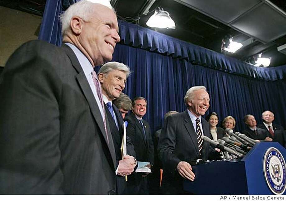 Sens. John McCain, R-Ariz., left to right, John Warner, R-Va., Ben Nelson, D-Neb., obscured, Mark Pryor, D-Ark., Joe Lieberman, D-Conn., Olympia Snowe, R-Maine, Mary Landrieu, D- La., Lindsey Graham R-S.C., and Ken Salazar, D-Colo., laugh durihg a press conference, announcing that an agreement was reached between 14 senators, seven Democrats and seven Republicans, to try to avert a crisis in the United States Senate, during a press conference on Capitol Hill, Monday, May 23, 2005, in Washington. (AP Photo/Manuel Balce Ceneta) Photo: MANUEL BALCE CENETA