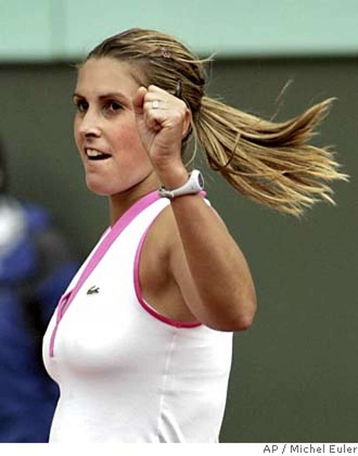 Spain's Maria Sanchez Lorenzo reacts after defeating defending champion Russia's Anastasia Myskina in their first round match of the French Open tennis tournament at the Roland Garros stadium, Monday, May 23, 2005 in Paris. Sanchez Lorenzo won 6-4, 4-6, 6-0. (AP Photo/Michel Euler) Photo: MICHEL EULER