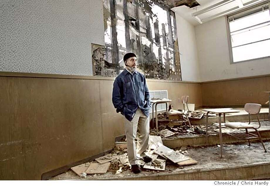 schoolfire24_ch_027.jpg  Matin Abdel-Qawi, principal of the East Oakland school of the arts looks at the damage to the music room.  Fire at the music school at the Castlemont Community of Small Schools in Oakland in Oakland  5/23/05 Chris Hardy / San Francisco Chronicle Photo: Chris Hardy