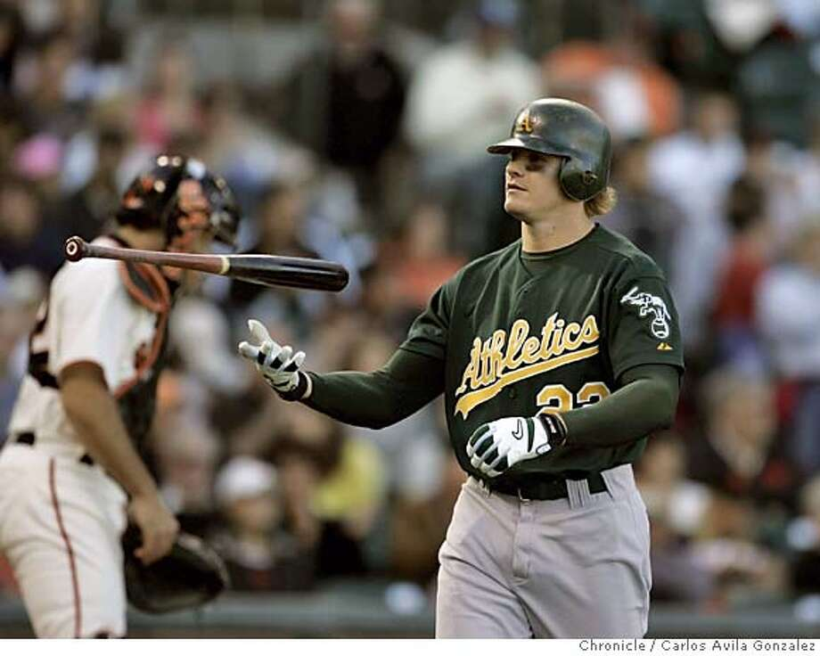 Athletics' left fielder, Eric Byrnes, flips his bat in frustration after striking out in the top of the fourth inning. The San Francisco Giants played the Oakland Athletics at SBC Park in San Francisco, Ca., on Sunday, May 22, 2005. The Giants defeated the Athletics 3-1.  Photo by Carlos Avila Gonzalez / The San Francisco Chronicle  Photo taken on 5/22/05, in San Francisco,CA. Photo: Carlos Avila Gonzalez