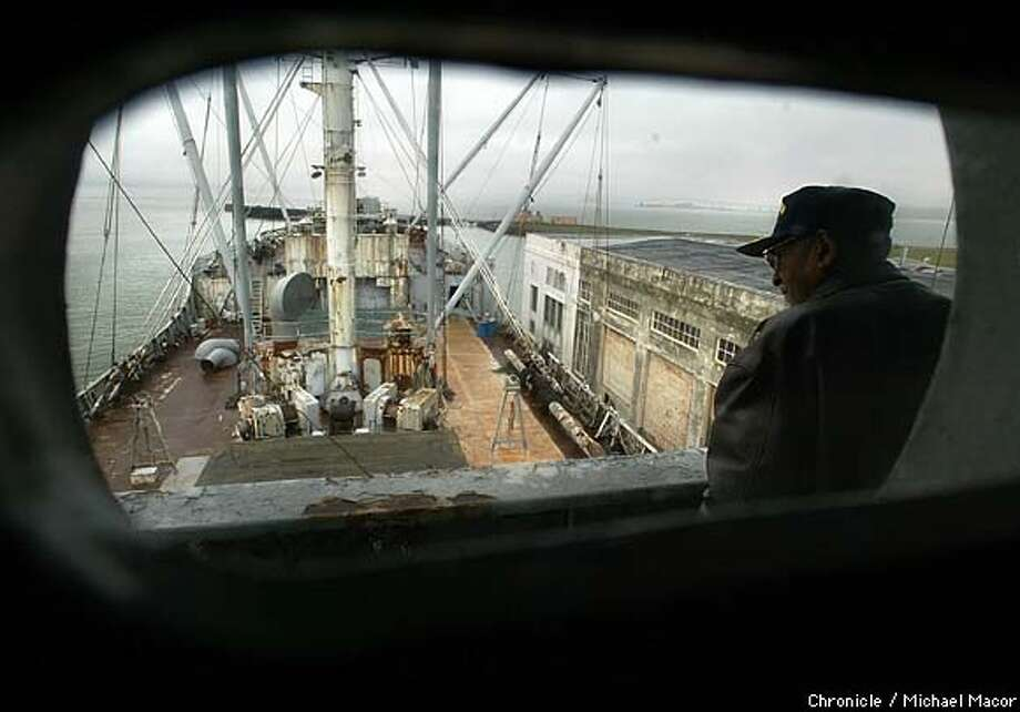 Chief Engineer Jackson, looks out over the ship from the bridge. When the Victory Ship Red Oak finally sails across the Bay someday it will be partly do to the doing of Chief Engineer William Jackson, 84. The Red Oak Victory Ship, a floating museum owned by the Richmond Museum of History. Through volunteers the ship is slowly being restored to sail once again. by Michael Macor/The Chronicle Photo: MICHAEL MACOR