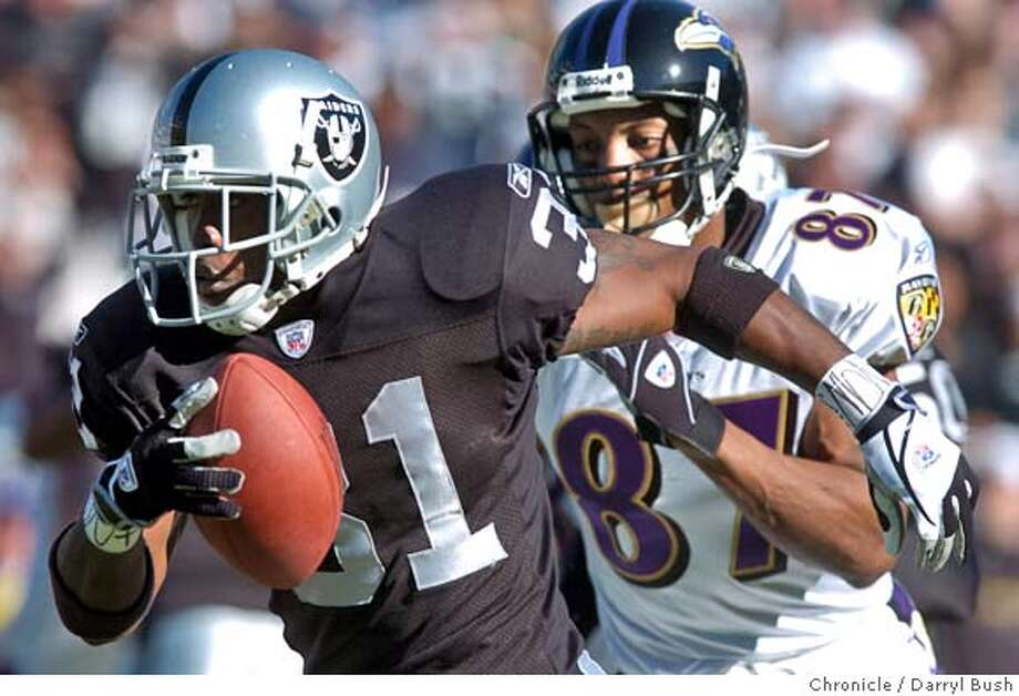 raiders15_056db.jpg  Oakland Raiders Phillip Buchanon runs back an interception he made in the 1st qtr. vs. Baltimore Ravens at Networks Associates coliseum. 12/14/03 in Oakland. DARRYL BUSH / The Chronicle Ran on: 09-09-2004  Phillip Buchanon: more consistent? MANDATORY CREDIT FOR PHOTOG AND SF CHRONICLE/ -MAGS OUT Sports#Sports#Chronicle#11/28/2004#ALL#2star##0421529925 Photo: DARRYL BUSH