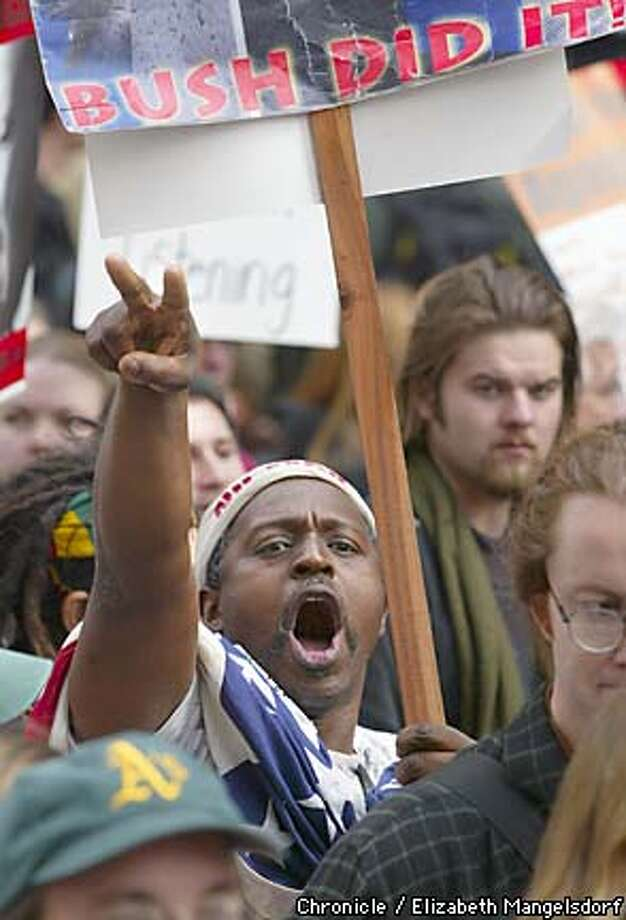 PROTEST14-C-16FEB03-MT-LM  SF resident Renaldo Manuel Ricketts yells as he marches down market street during the huge anti-war march in San Francisco on Sunday February 16th. SAN FRANCISOC CHRONICLE/Liz Mangelsdorf Photo: Liz Mangelsdorf