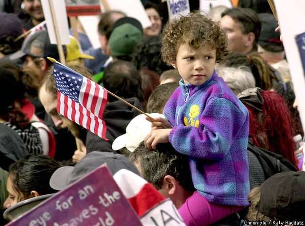 PHOTO BY KATY RADDATZ--THE CHRONICLE  Anti war march in San Francisco. SHOWN: People of many ethnicities and ages marched for peace; many made the point that peace is NOT unpatriotic. (There is NO NAME available for this child).