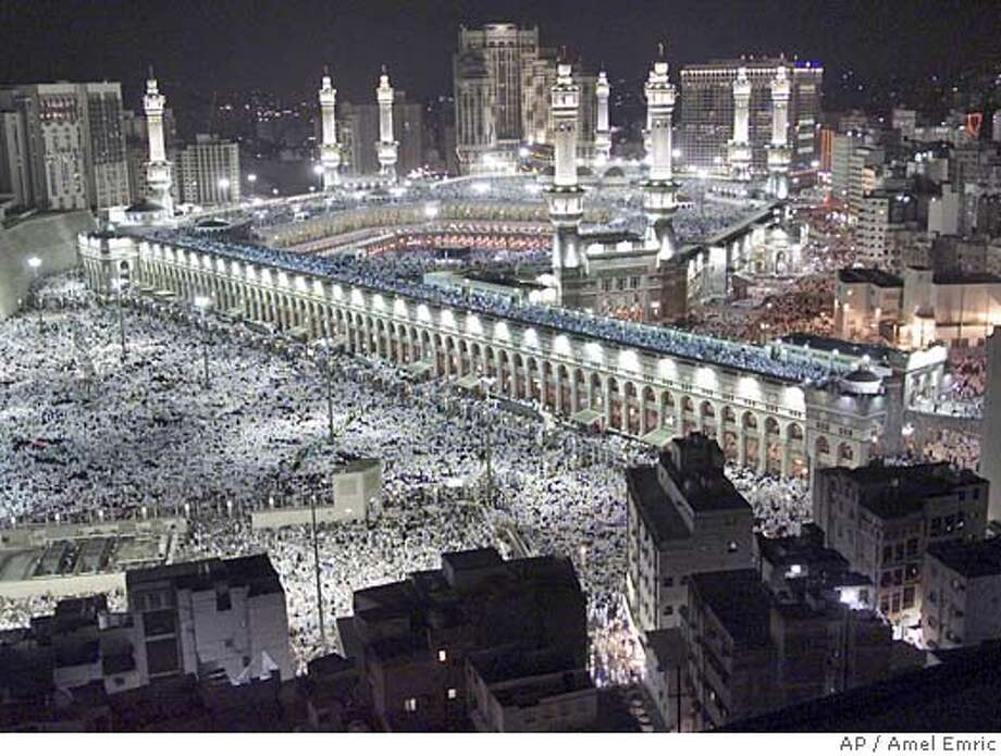 Thousands of Muslims gather around the holy Kaaba, cube at center, of the Grand Mosque during evening prayer in the holy city of Mecca in Saudi Arabia on Saturday, Feb. 8, 2003. About 2 million Muslim pilgrims from all over the world will gather in Mecca to perform the Hajj pilgrimage. The Hajj is one of the most sacred duties of the Muslim faith and is required at least once by every able bodied Muslim who can afford it. (AP Photo/Amel Emric) Ran on: 11-28-2004  The Great Mosque in Mecca, Saudi Arabia, has several features that have been copied in western architecture, including pointed arches, domes and minarets.. Photo: AMEL EMRIC