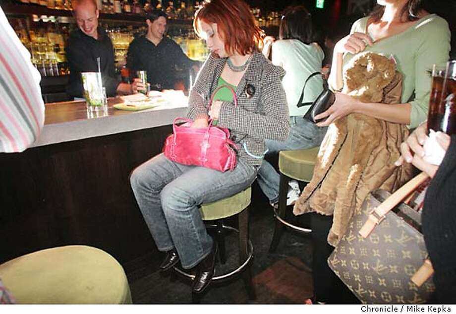 onlocationMatrix0053_mk.jpg 10:20 p.m. Wendi Holmes puts her lipstick away at the bar in Matrixfilmores on the corner of Fillmore and Greenwich in San Francisco. on Location - Matrixfillmore in Cow Hollow. 11/18/04  Mike Kepka/The Chronicle MANADATORY CREDIT FOR PHOTOG AND SF CHRONICLE/ -MAGS OUT Living#Living#Chronicle#11/28/2004#ALL#5star##0422475922 Photo: Mike Kepka