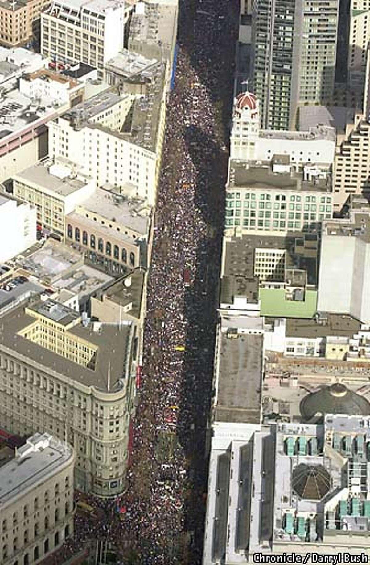 Peace marchers on Market Street in San Francisco Chronicle Photo by Darryl Bush