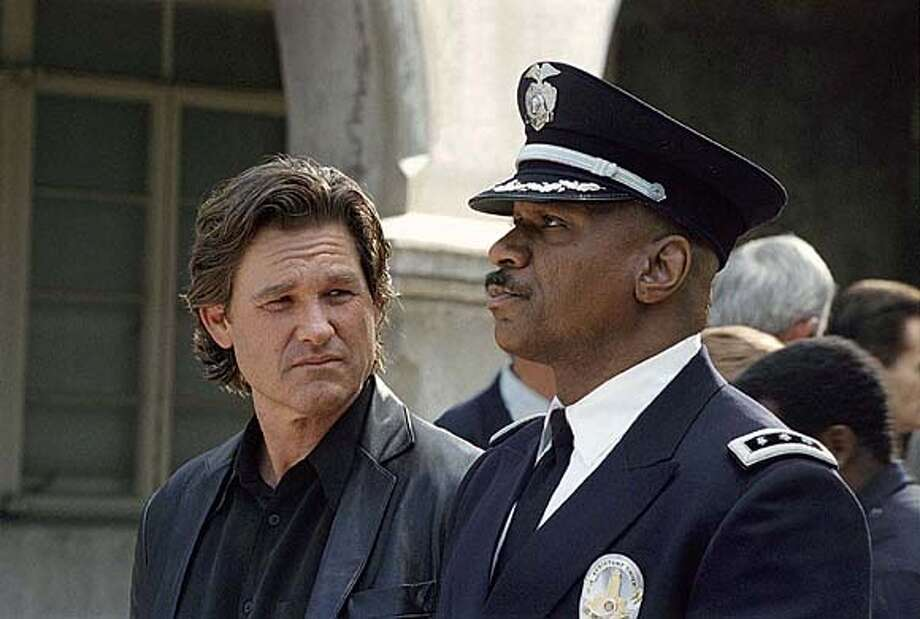 "A member of the LAPDs elite Special Investigations Squad Eldon Perry (Kurt Russell) is confronted by Assistant Chief Holland (Ving Rhames) about his tough street tactics in United Artists' ""Dark Blue."" (AP Photo/United Artists)"