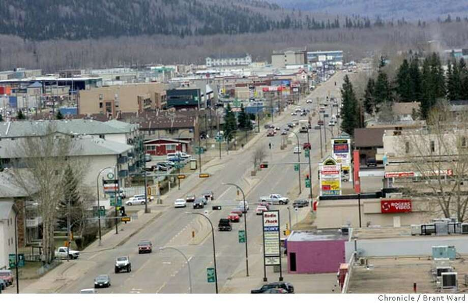 """The town of Fort McMurray as seen from the mayors office. The downtown area is a series of stip malls. A lack of affordable housing is a big concern to miners in the area.  The oil sands area of Alberta, Canada is perhaps the answer to  Canada and America's energy needs for the next 40 years. The oil is attached to tiny grains of sand and dirt and is being mined all around the city of Fort McMurray.  This has caused a """"boomtown"""" atmosphere in the small town. Even with good salaries for workers at the oil sands, rents and home prices rival Northern California. Many of the """"homeless"""" make over $30,000 a year, but still can't afford the high rents. The young workers go a little crazy on weekends at the local casino and bars...the famous mounties must patrol outside.  This is a portrait of the oil sands and the town that is paying the price. Brant Ward 4/19/05 Photo: Brant Ward"""